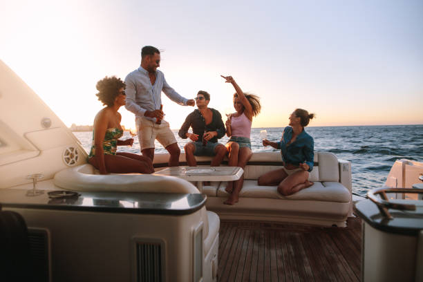 Group of friends enjoying in a boat party - fotografia de stock