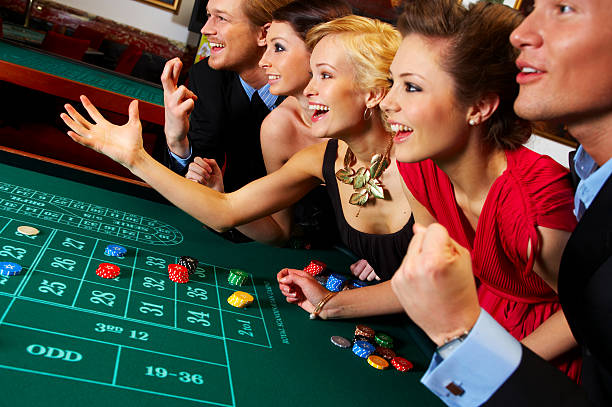 Group of friends enjoying in a casino Group of friends enjoying in a casino game of chance stock pictures, royalty-free photos & images