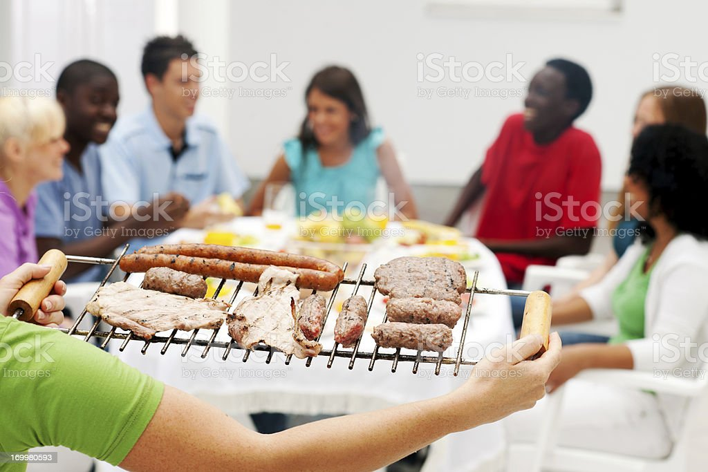 Group of friends enjoying in the barbecue. royalty-free stock photo