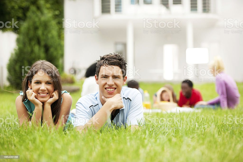 Group of friends enjoying in the park royalty-free stock photo