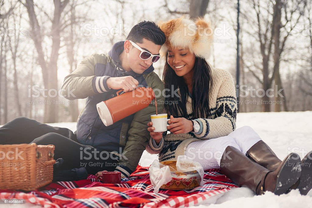 Group of friends enjoying in the snow in winter stock photo