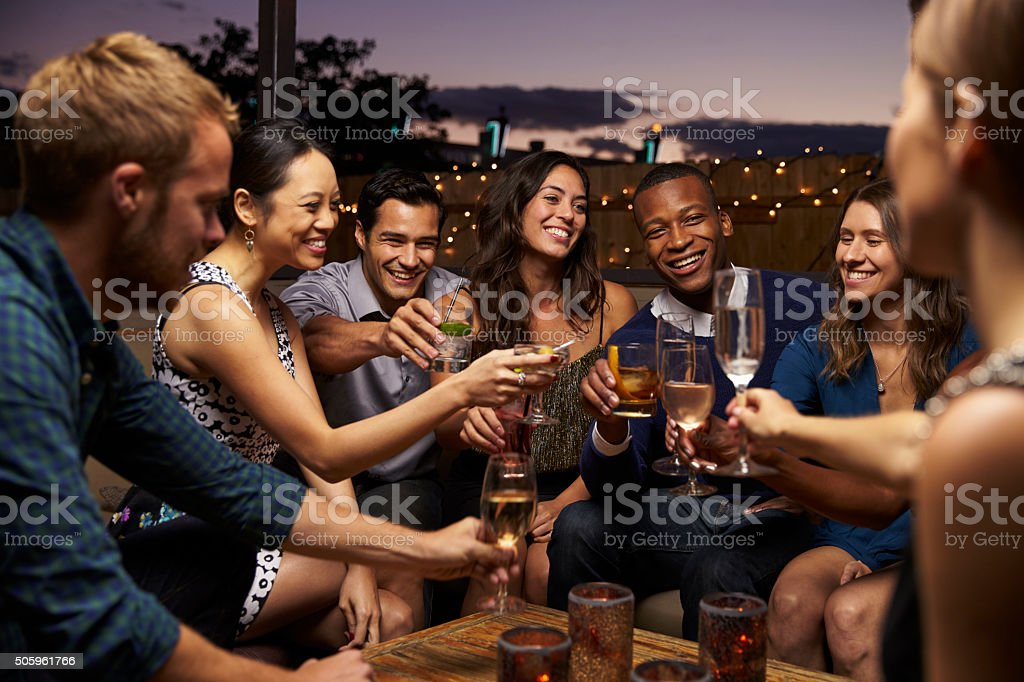 Group Of Friends Enjoying Night Out At Rooftop Bar royalty-free stock photo