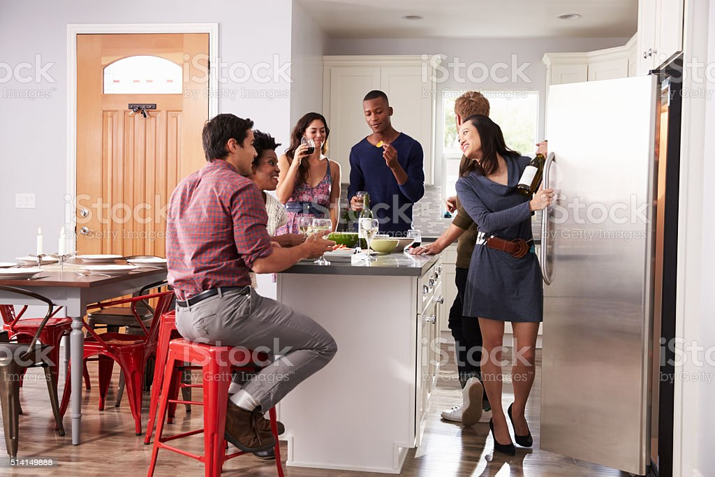 Group Of Friends Enjoying Pre Dinner Drinks At Home stock photo