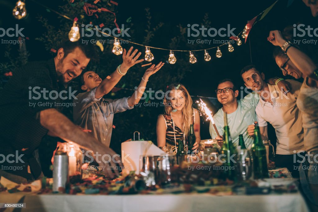 Group of friends enjoying the backyard birthday party stock photo