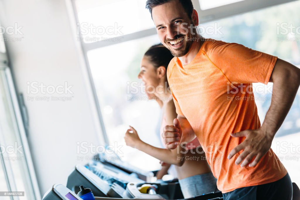 Group of friends exercising on treadmill machine stock photo