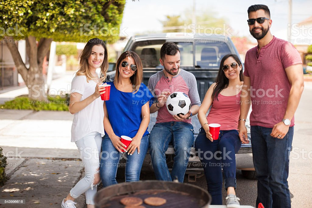 Group of friends hanging out at a soccer game - Photo