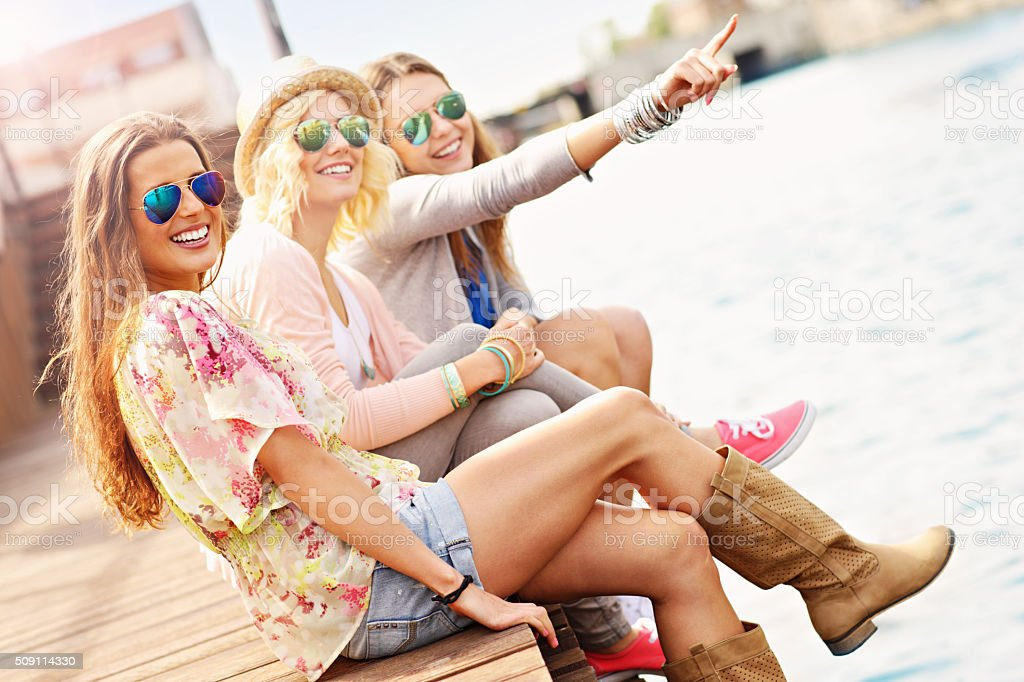 Group of friends hanging out in the city stock photo