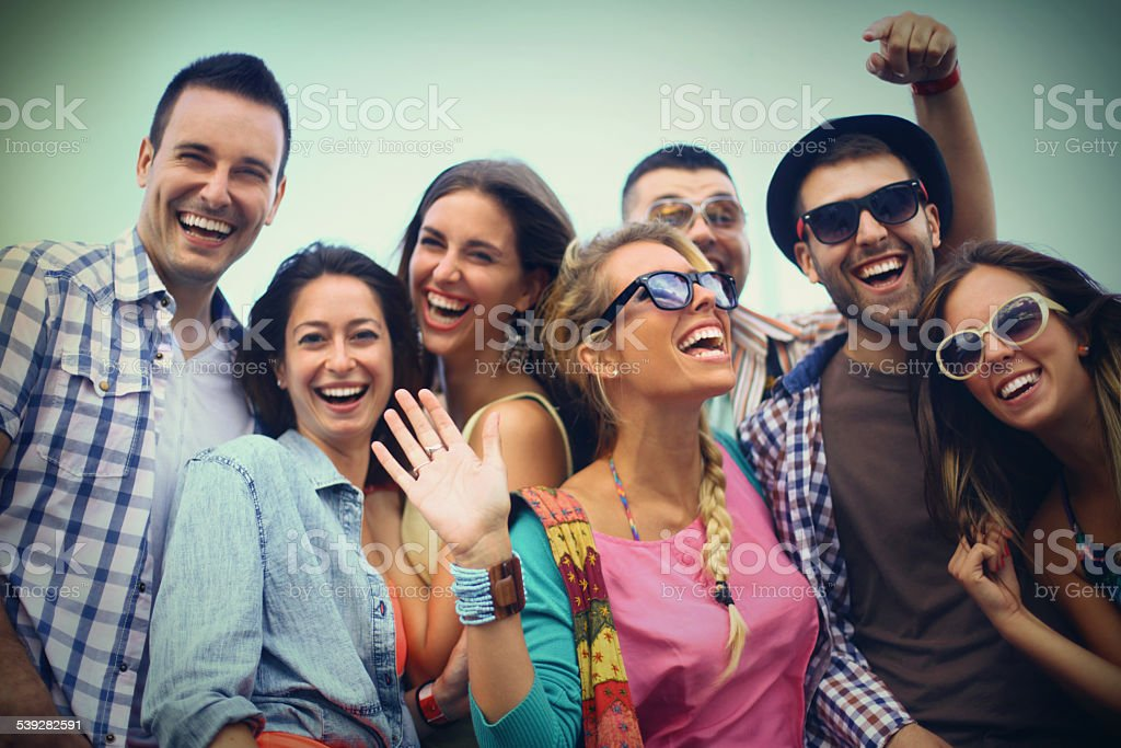 Group of friends hanging out. stock photo