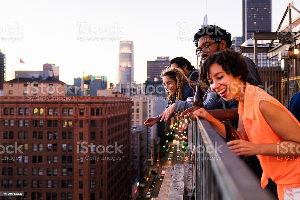 Group of friends hanging out together stock photo