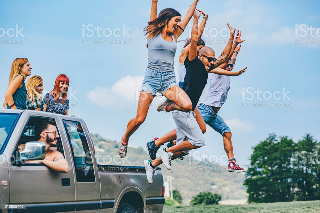 group of friends have fun on the van togetherness stock photo