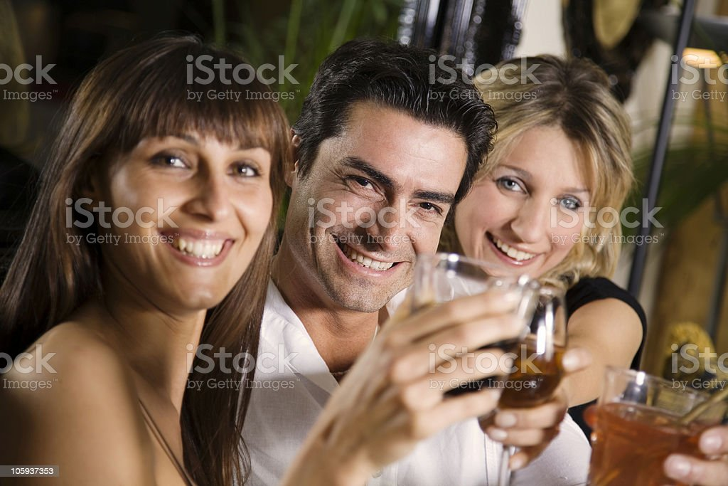 A group of friends having a drink  royalty-free stock photo