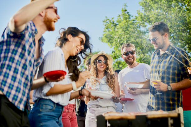 Group of friends having a good time at outdoor party stock photo