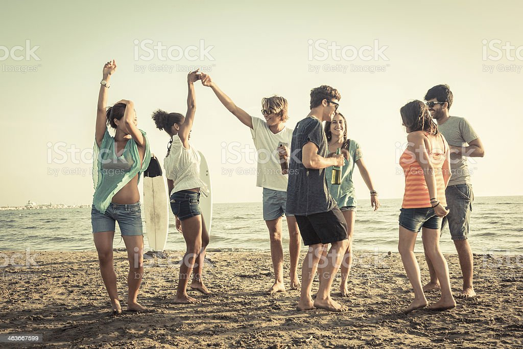 Group of Friends Having a Party on the Beach stock photo