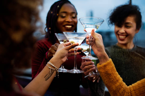 Group of friends having a party Group of friends having a party martini stock pictures, royalty-free photos & images