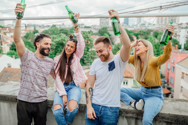 Group of friends having a rooftop party at terrace stock photo