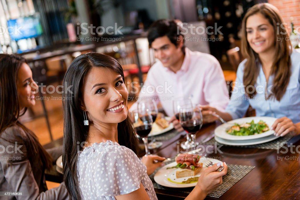 Group of friends having dinner stock photo