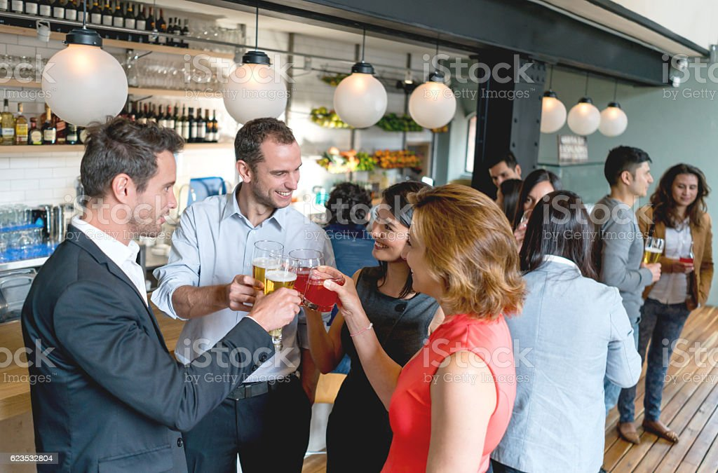 Group of friends having drinks after work stock photo