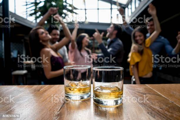 Group of friends having drinks at a bar picture id828241676?b=1&k=6&m=828241676&s=612x612&h=zc3z ppfdngt r7v8may45hgcnw1domd1v 9xezkcyi=