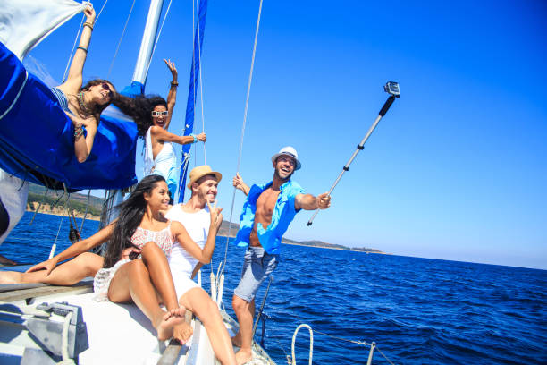 Group of friends having fun and making selfie on yacht - fotografia de stock