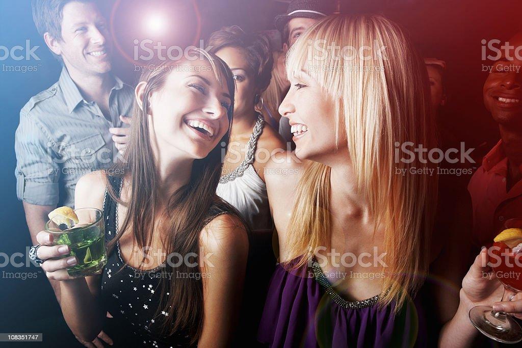 Group of friends having fun at nightclub stock photo