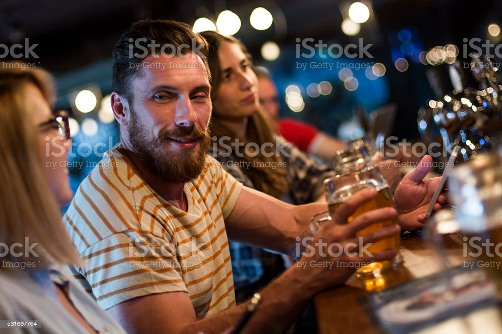 Group of friends having fun at the bar stock photo