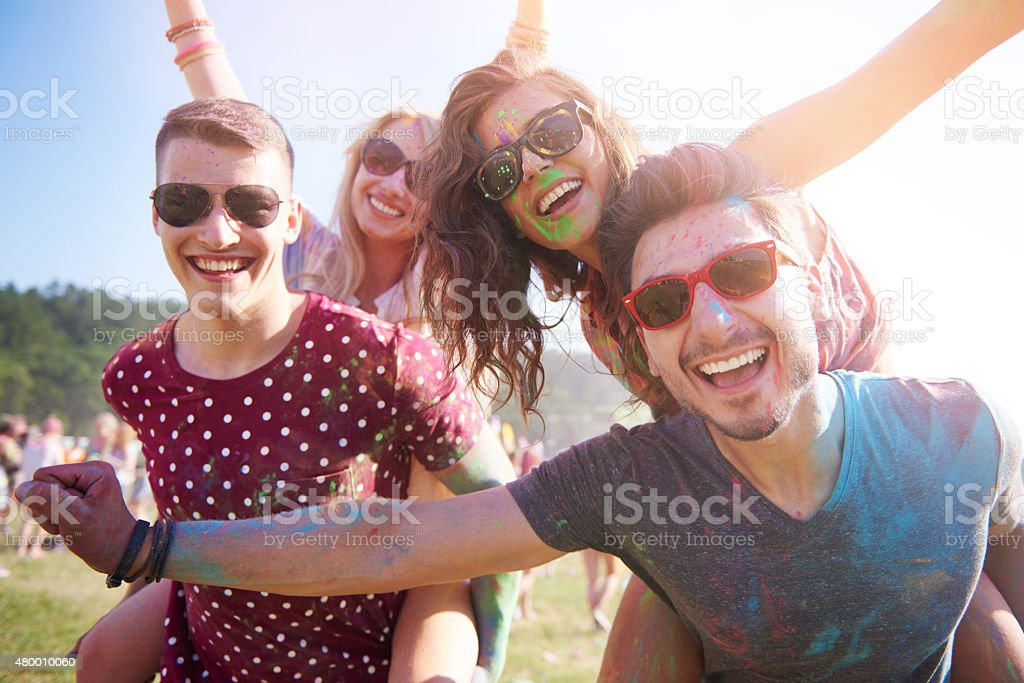 Group of friends having fun at the festival stock photo