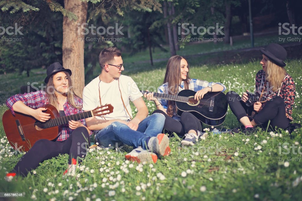Group of friends having fun in a park royalty-free stock photo
