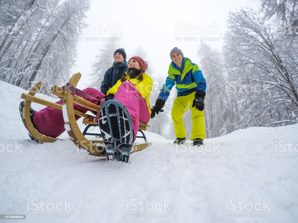 Group of friends having fun in a winter vacation stock photo