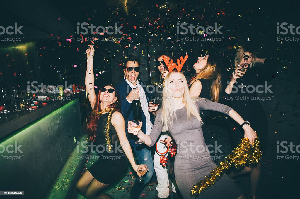 Group of friends having fun in the club stock photo