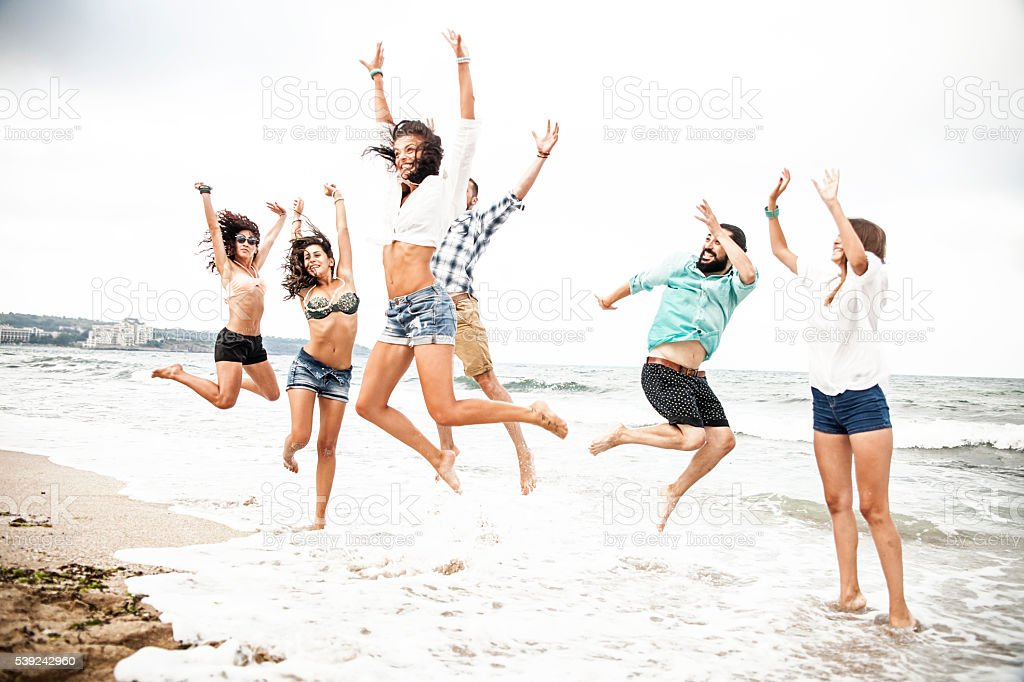 Group of friends having fun in the sea royalty-free stock photo