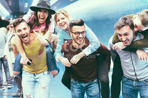 istock Group of friends having fun in underground metropolitan station - Young people hanging out ready for party night - Friendship and youth lifestyle concept - Focus on center girl face 1051239748