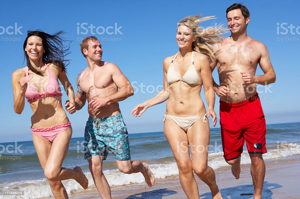 Group Of Friends Having Fun On Beach Holiday Together stock photo