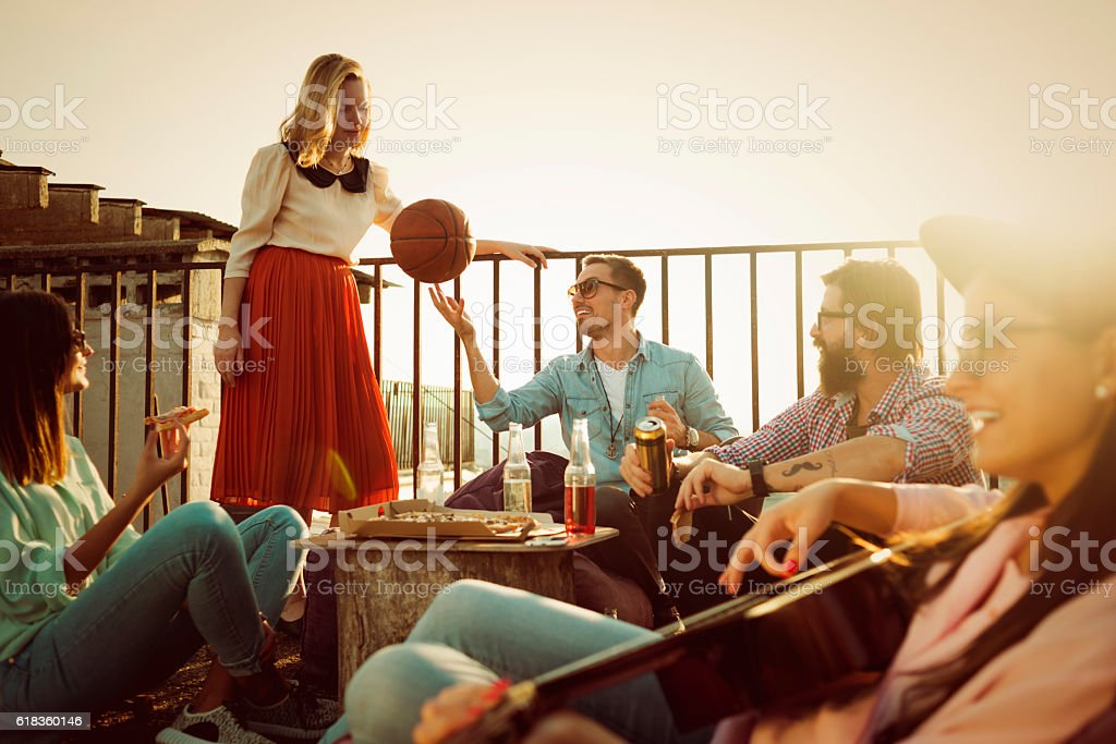 group of friends having fun on the roof - foto stock