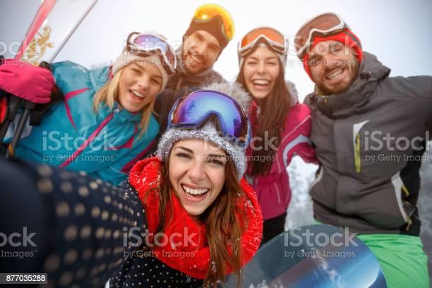 Group of friends having fun on the snow and making selfie picture id877035288?b=1&k=6&m=877035288&s=612x612&h=unr9inbgapiydugis1j8qsjdttkv6jjsvytsyt0omb4=