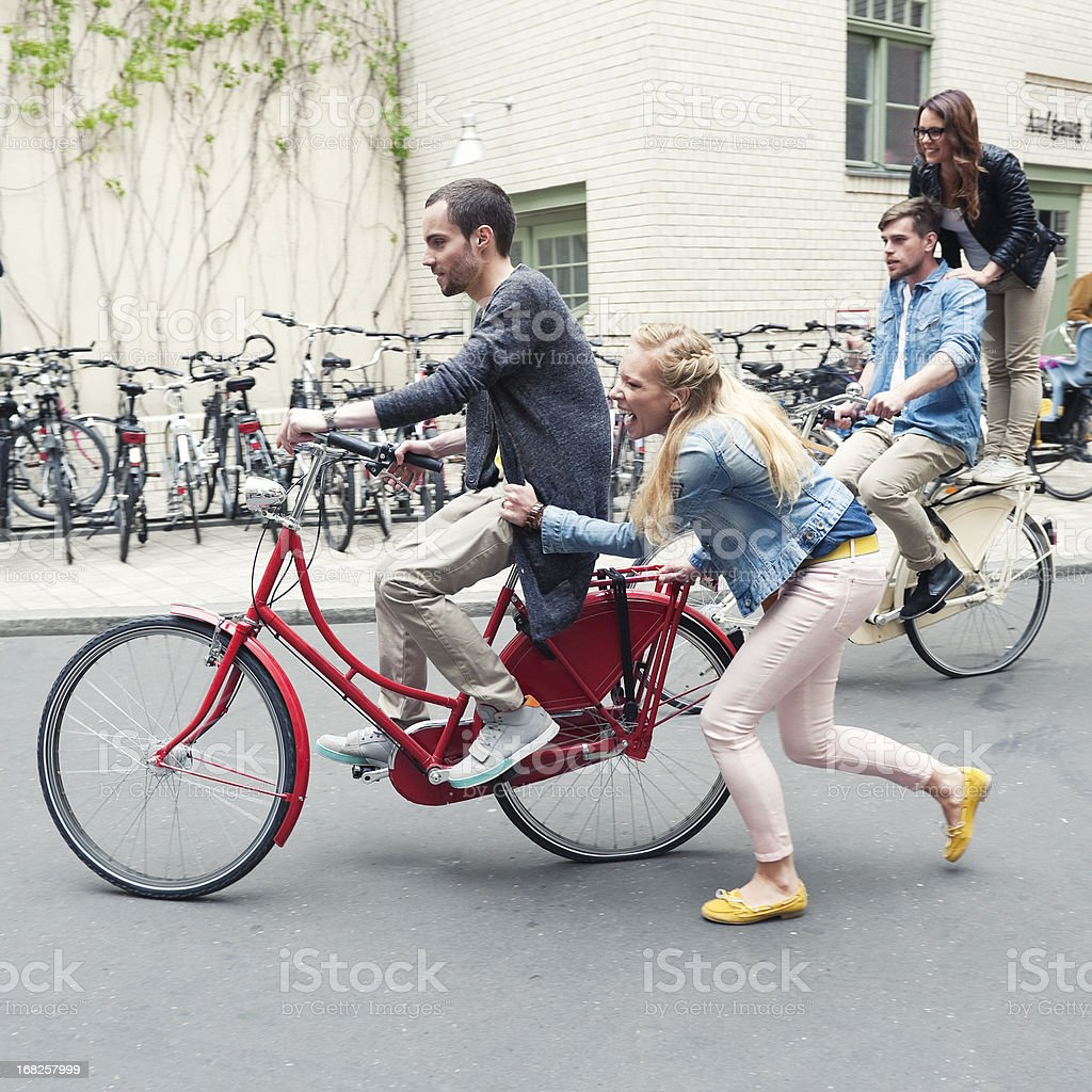 Group of friends having fun on their bikes in Berlin stock photo