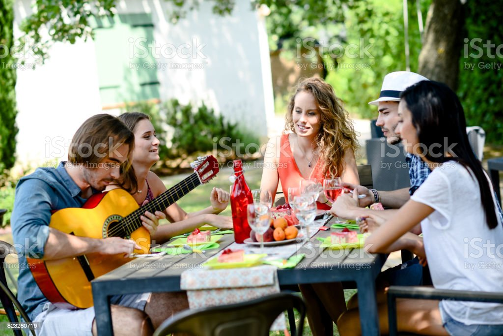 Group Of Friends Having Fun Picnic Lunch Party Outdoor In ...