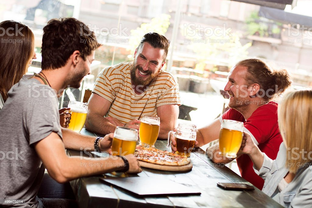 Group of friends having fun stock photo