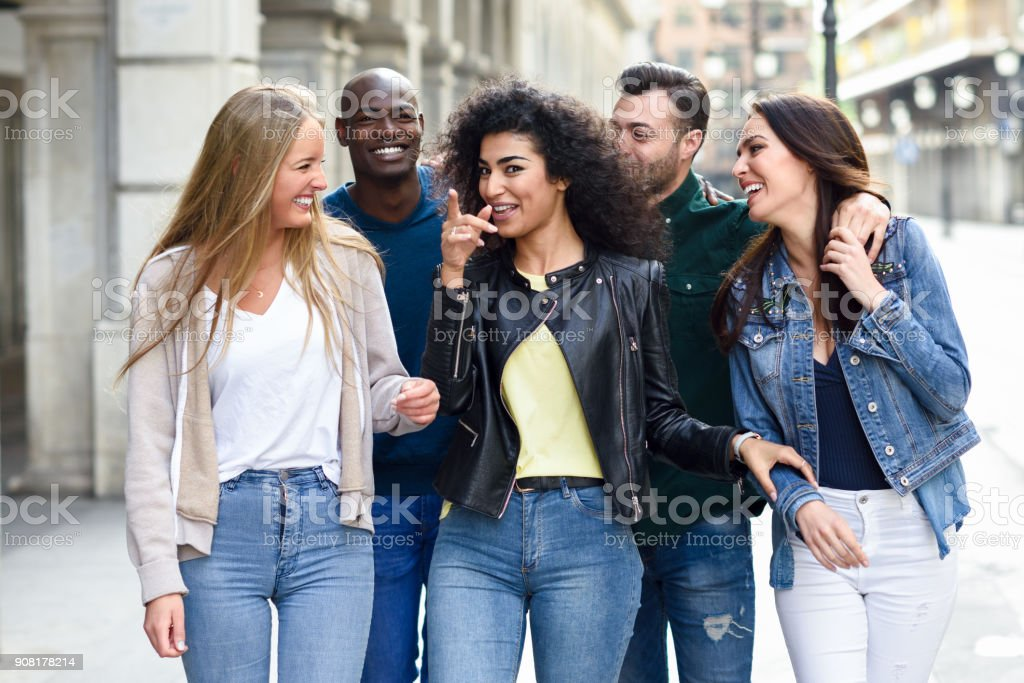 Group of friends having fun together outdoors stock photo