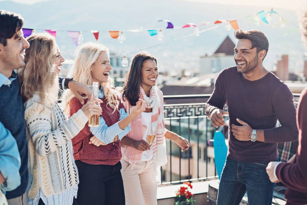 Group of friends having fun together stock photo