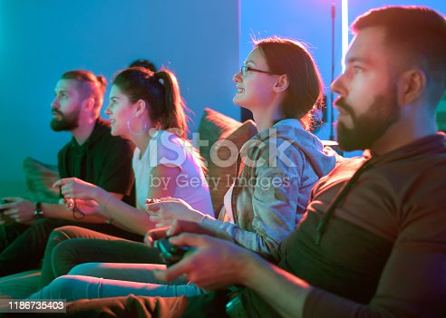 Group of friends having fun while playing video games