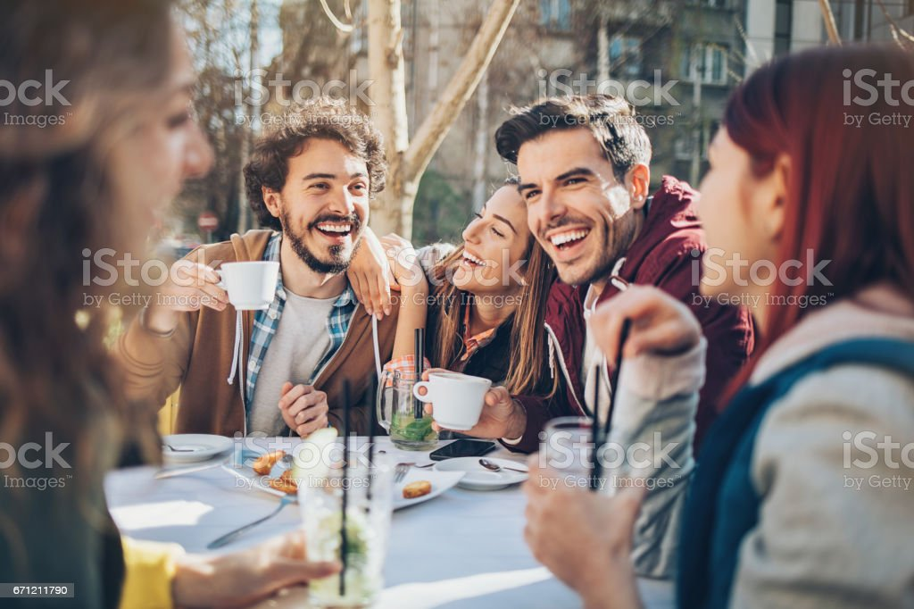 Group of friends having lunch outdoors stock photo