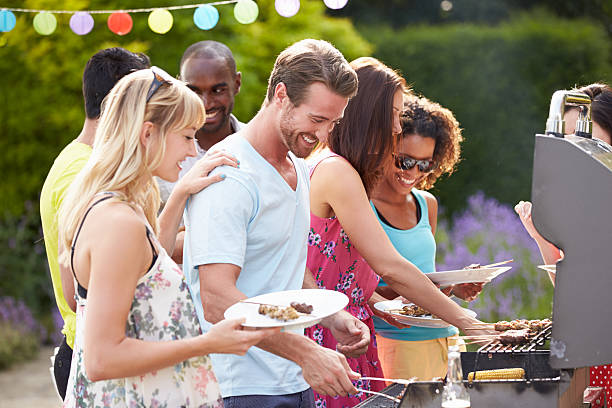 group of friends having outdoor barbeque at home - grilled stock photos and pictures