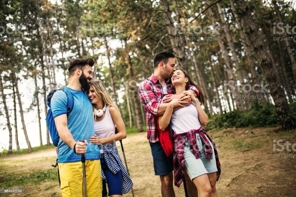Group of friends hiking together in the forrest - Royalty-free A Helping Hand Stock Photo