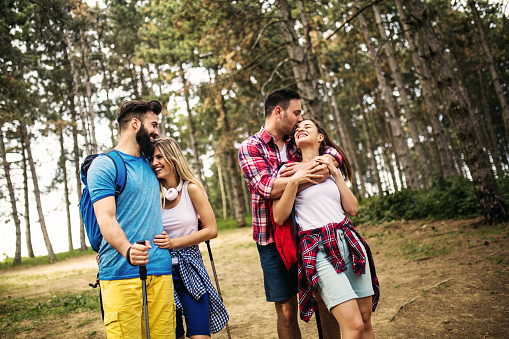 Group Of Friends Hiking Together In The Forrest Stock Photo - Download Image Now
