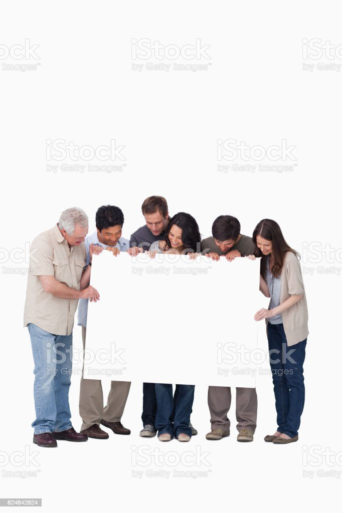 Group of friends holding blank sign together stock photo