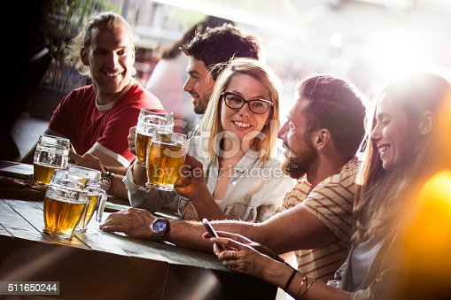istock Group of friends in a bar 511650244