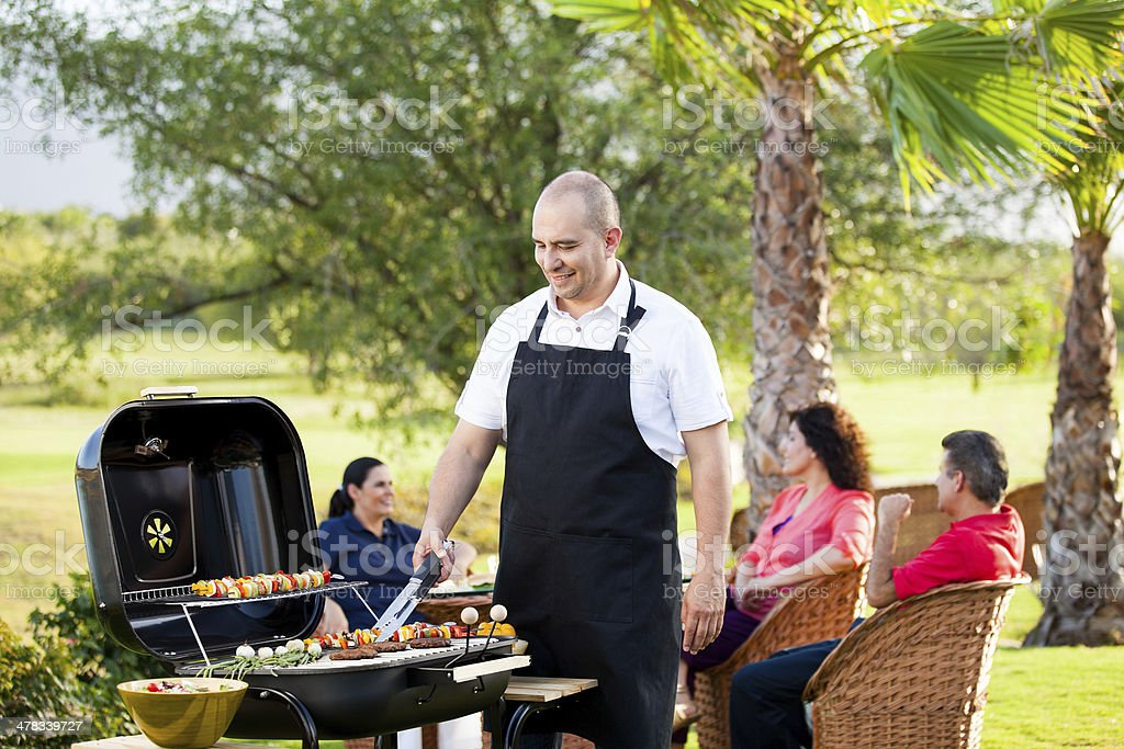 Group of friends in a barbecue royalty-free stock photo