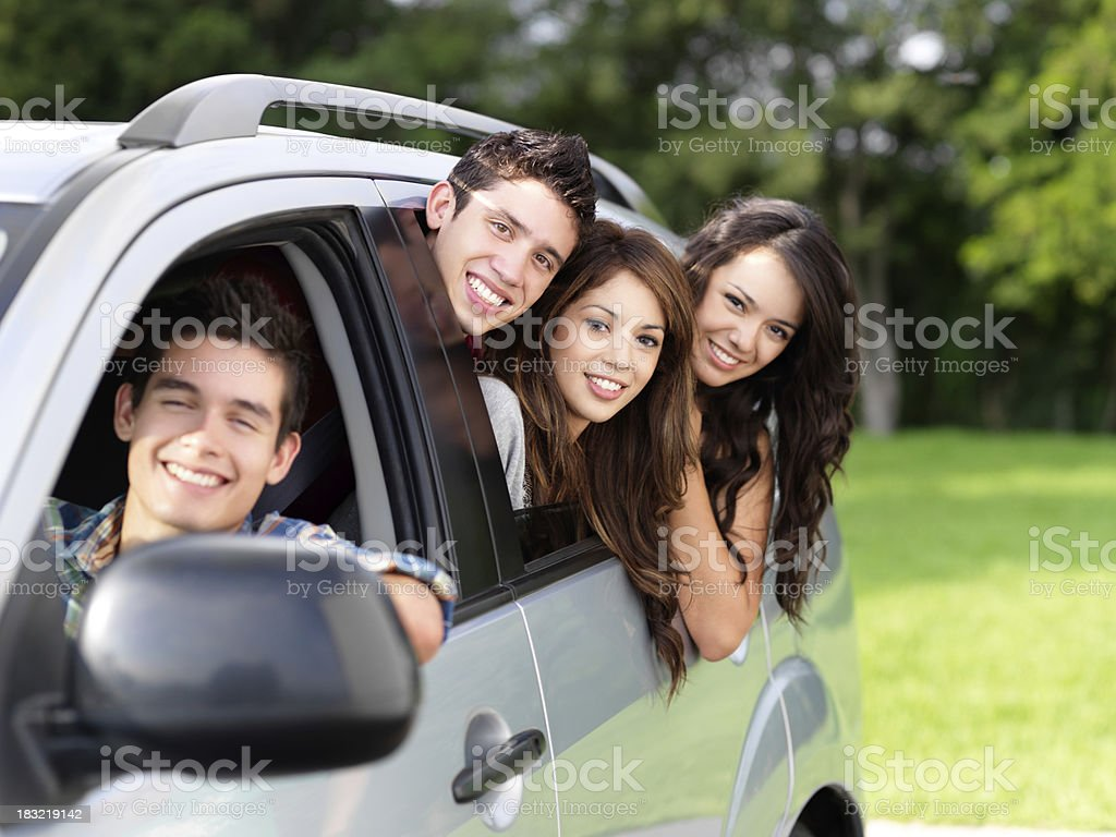 Group of friends in a car royalty-free stock photo
