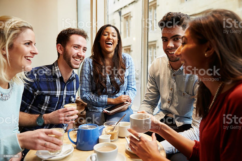 Group Of Friends In Caf' Using Digital Devices stock photo