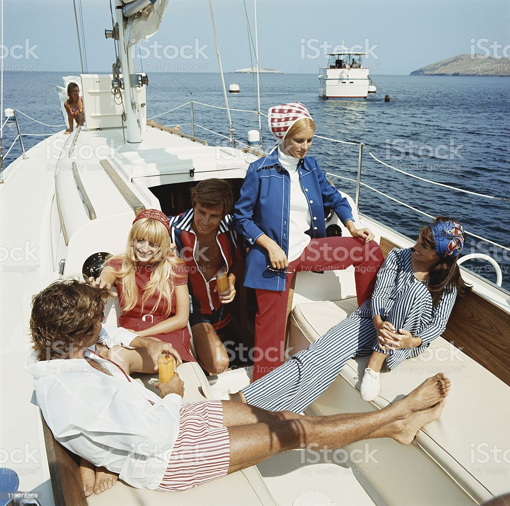 Group of friends in sailing boat stock photo